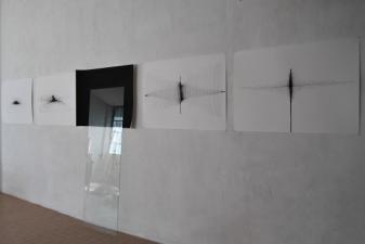 """""""Strutturare i propri pensieri partendo da uno stato di zero assoluto"""",2010, installation glass,ink on paper, overall dimensions cm.""""180x380x20"""""""